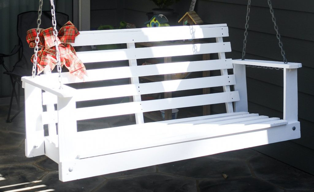 wooden porch swing after restoration