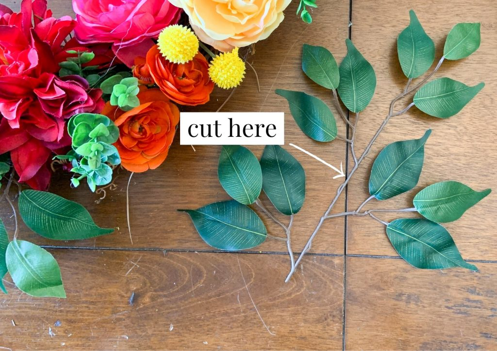 cut greenery to add layers to spring wreath