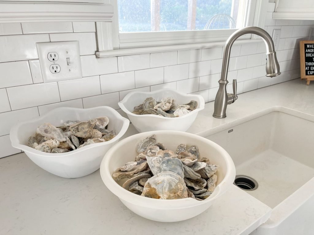 gather oyster shells into large bowls for bleaching