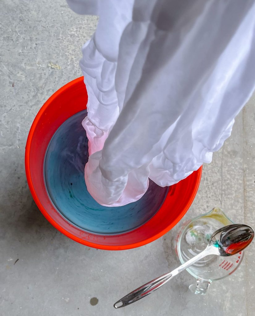 place fabric in the dye bath