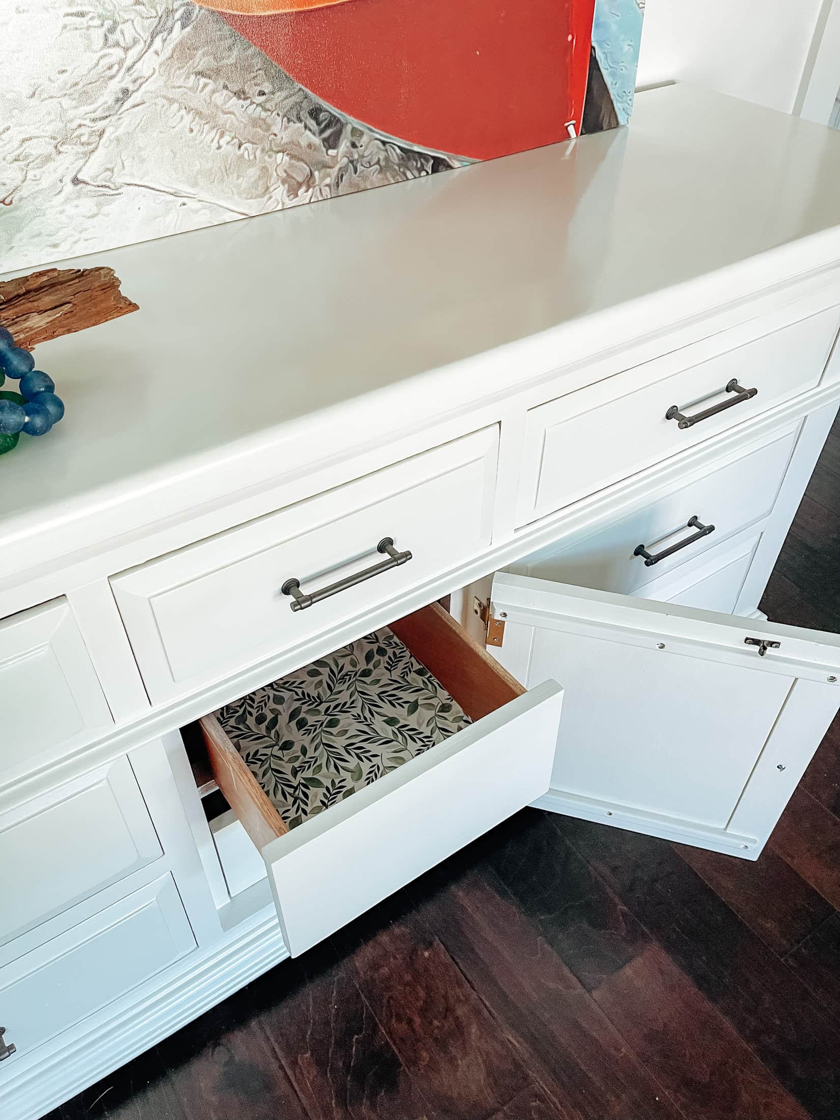 Line drawers of vintage dressers with gift wrap